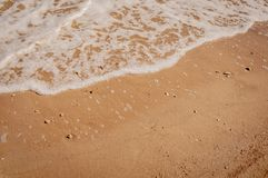 White waves of Azove sea on a red sand stock photos