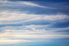 White wavy clouds on blue sky Stock Image