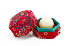 White wax capsule of Chinese medicine in red hexagon box Stock Image