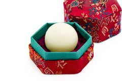 White wax capsule of Chinese medicine in red hexagon box Royalty Free Stock Photos