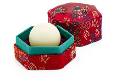 White Wax Capsule Of Chinese Medicine In Red Hexagon Box Royalty Free Stock Image