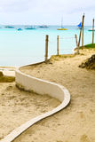 White way on yellow sand beach near blue tropical sea, Philippin Royalty Free Stock Image