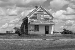 White weather beaten house. Abandoned white weather beaten house Royalty Free Stock Photography