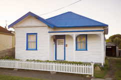 White weatherboard house. Exterior view of white weatherboard house in suburban street royalty free stock photography