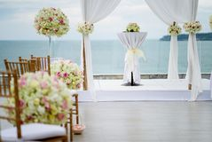 White wedding arch decorated with flowers, floral. The wedding venue decorated with flower, floral, The panoramic ocean view in background Stock Images