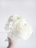 White wedding or birthday bouquet made of Persian buttercup, Ranunculus and daffodil, Narcissus, flowers. Blurred Royalty Free Stock Images