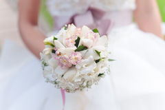 White wedding bouquet. Bride with a white wedding bouquet Stock Image