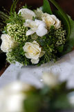 White wedding bouquet. A view of a pretty bouquet of an assortment of white flowers with green trimmings used in a wedding Royalty Free Stock Images