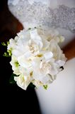 White wedding bouquet. Close up of a bride's hands holding a white wedding bouquet Stock Images