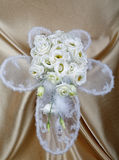 White wedding bouquet against a fabric Stock Photos