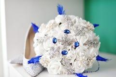 White wedding bouquet and bride shoes. White artificial wedding bouquet and bride shoes Royalty Free Stock Photos