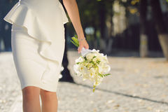 White Wedding Bouquet. Bride with white wedding bouquet in street Royalty Free Stock Images