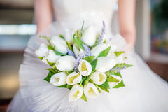 White Wedding bouquet close-up. White Wedding bouquet on Bride`s Hand Stock Photography