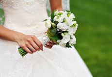White wedding bouquet in hands of the bride.  Royalty Free Stock Images