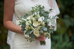 White wedding bouquet in the hands of the bride.  Stock Photo