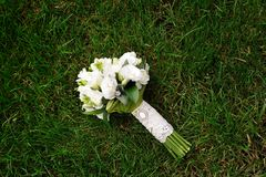 White wedding bouquet. Lying on green grass Stock Images