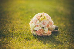 White wedding bouquet lying on green grass Royalty Free Stock Images