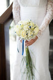 White wedding bouquet with roses. Colorful wedding bouquet with roses in brides hands Stock Photo