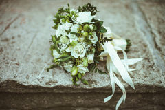 White wedding bouquet. On a stone background Stock Images
