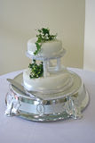 White Wedding Cake - 2. A traditional two-layered wedding cake, complete with a silver pedestal and knife Stock Photos