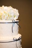 White Wedding Cake. With Blue Ribbon Stock Photos