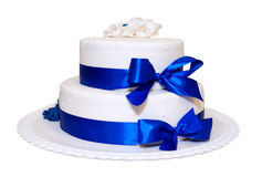 White wedding cake with blue ribbons. Shot of white wedding cake with blue ribbons on white background Stock Images