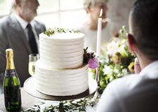 White Wedding Cake with Champagne Bottle Stock Images