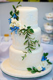White wedding cake decorated with flowers Royalty Free Stock Photos