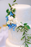 White wedding cake decorated with flowers Royalty Free Stock Images