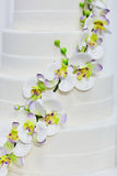 White wedding cake decorated with flowers Royalty Free Stock Photography