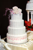 White wedding cake decorated with pink flowers Royalty Free Stock Image