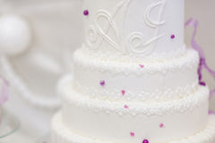 White wedding cake decorated with purple bubbles Royalty Free Stock Images