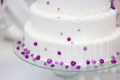 White wedding cake decorated with purple bubbles Stock Images