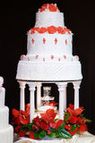 White wedding cake decorated with red flowers Royalty Free Stock Image