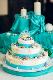 White  wedding cake decorated with seashells Stock Image