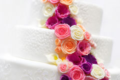 White wedding cake decorated with sugar flowers Royalty Free Stock Image