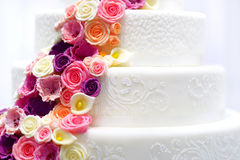 White wedding cake decorated with sugar flowers Stock Image