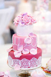 White wedding cake decorated with sugar flowers Royalty Free Stock Photo