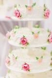 White wedding cake decorated with sugar flowers Stock Photos