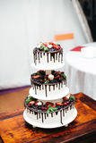 White wedding cake. Dessert, marriage event decoration, table Royalty Free Stock Photo