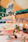 White wedding cake with flowers Royalty Free Stock Photos