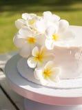 White Wedding Cake with frangipani Royalty Free Stock Photos