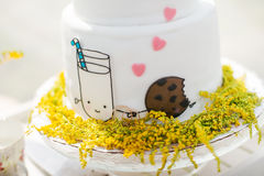 White wedding cake with gold rings Stock Photos