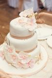White wedding cake with orchids Stock Image