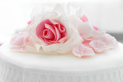White wedding cake with pink rose Stock Images