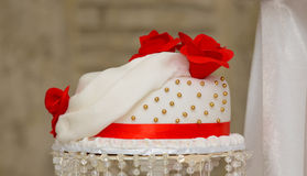 White wedding cake with red roses Stock Photo