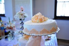 White wedding cake. With roses Stock Images