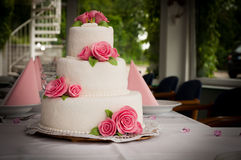 White wedding cake with roses. White wedding cake with the roses stock photo