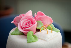 White wedding cake with roses. White wedding cake with the roses royalty free stock photos