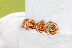 White wedding cake with roses decoration Stock Photo